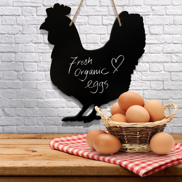 rustic chicken chalkboard - with a basket of fresh organic eggs