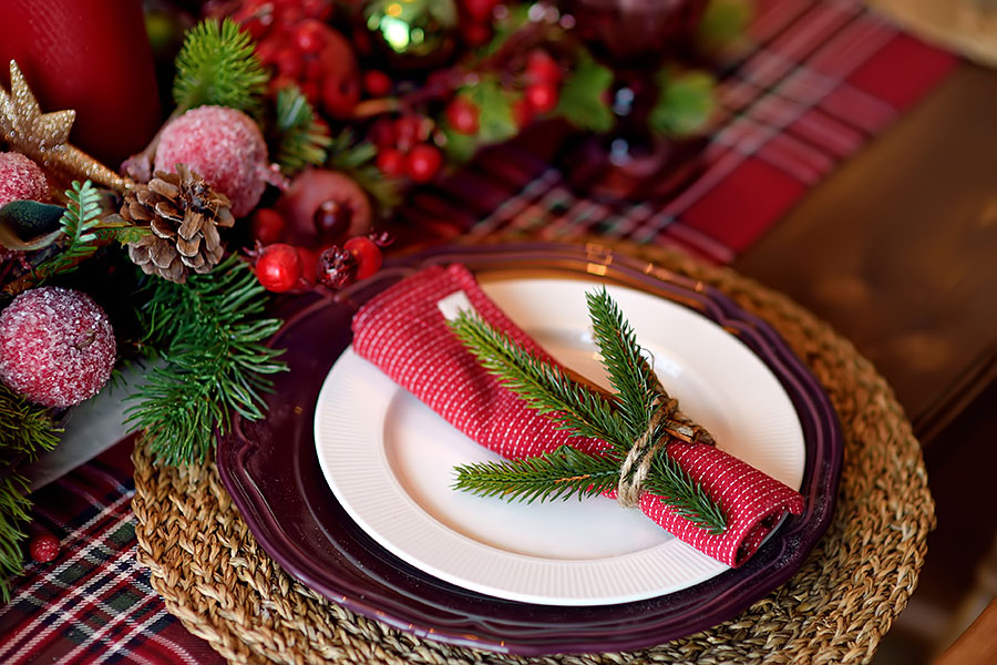 beautiful xmas table place setting with natural pine branches
