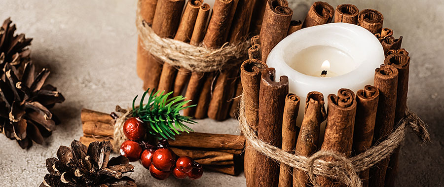 farmhouse styled christmas candles with cinnamon sticks and rustic twine