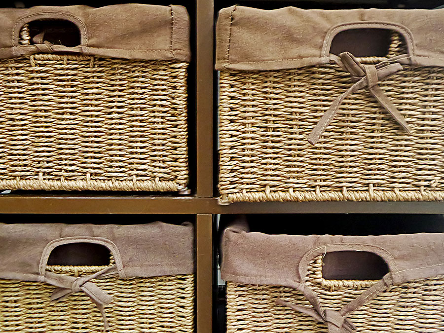 woven wicker baskets used for storage drawers