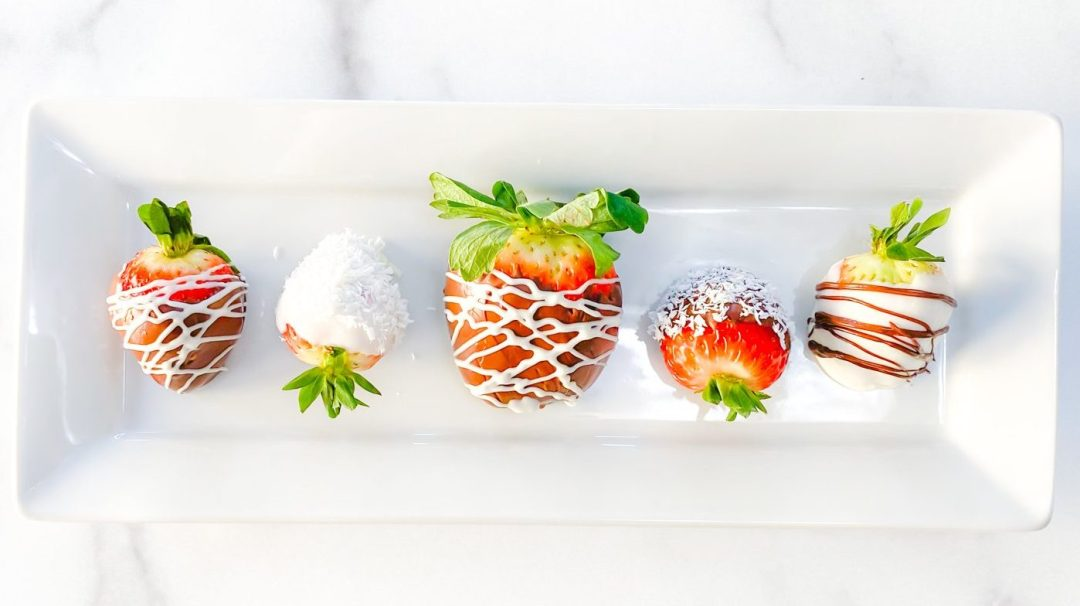 CBD Chocolate Covered Strawberries on White long rectangular plate