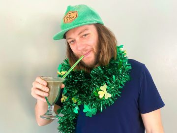 Blooming Botanicals owner sipping CBD Shamrock Shake