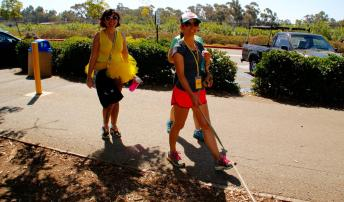 Toni, Kira, and Toni (and their furbaby) crossing the finish. photo by Richard Reyes