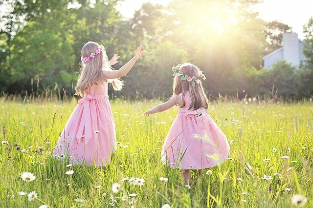 Two girls playing in a field during the summer holidays