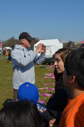 Paul LaMasters, Wings over Washington vice president, demonstrates how to make a kite perform skills.