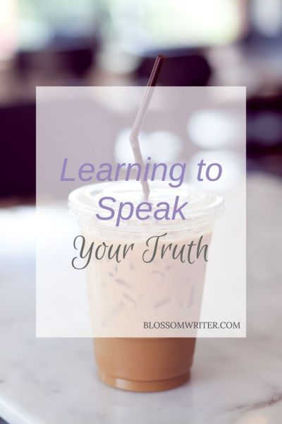 "An iced coffee sitting on a white table. Text reads, ""Learning to Speak Your Truth."""