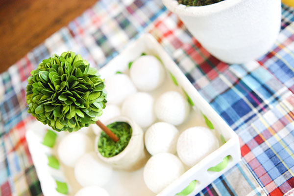 Love the use of golf balls in this Golf Party centerpiece!