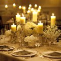 Of this candle centerpiece and all white flowers on plex wedding