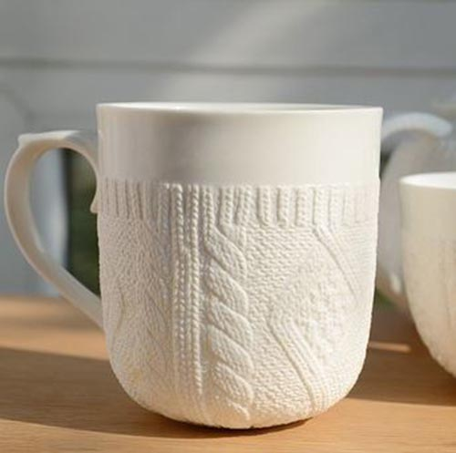 Love this white knitted sweater mug