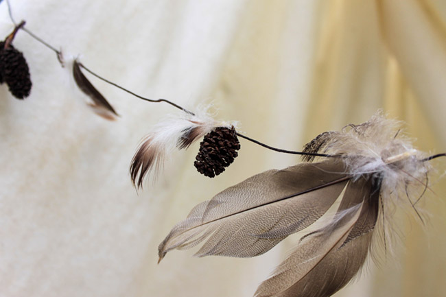 Easy DIY Feather and Pinecone Garland - See More Lovely Kid's Camp Out Ideas on B. Lovely Events