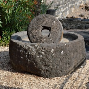 """These millstones were found so frequently in this area that it is now thought that this area may have been where they were made and sold. In Matthew 18:6, Jesus says, """"If any of you put a stumbling block before one of these little ones who believe in me, it would be better for you if a great millstone were fastened around your neck and you were drowned in the depth of the sea."""" It would be better! This millstone is huge! A terrifying warning."""