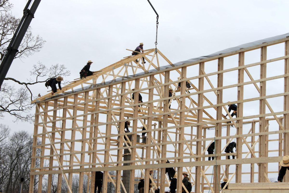 amish community raises barn