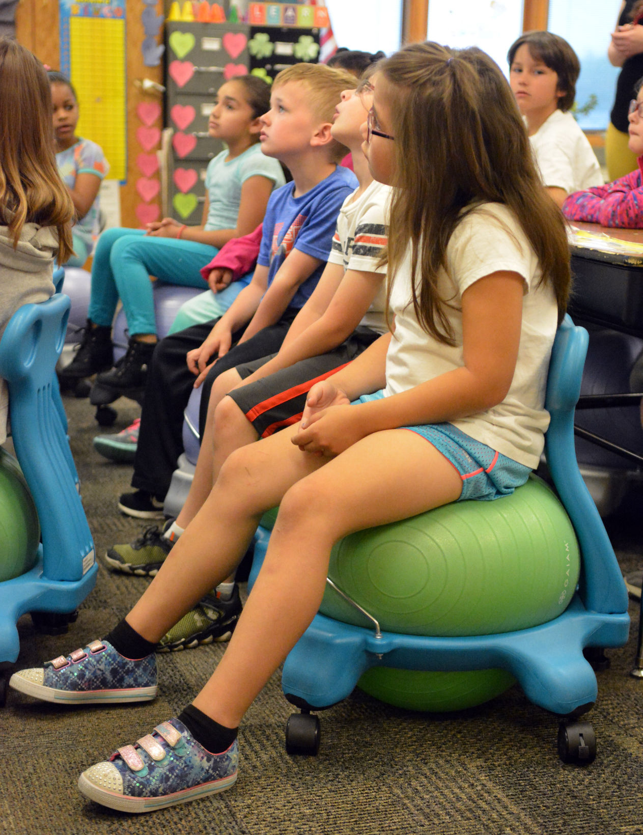 ball chairs for students nano gym chair give bounce local columbustelegram com lost creek elementary school first grade sit on that were added to the classroom this year alternative seating led improvements