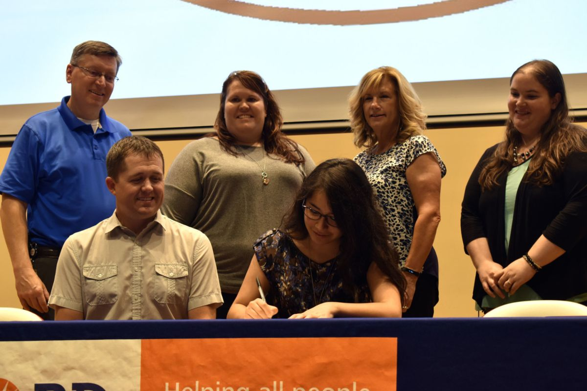 Senior Student Dariana Perales Signs Her Letter Of Intent To Bd Medical On  May 23 Inside Of Columbus High School's Auditorium During The School's  First-Ever