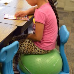 Ball Chairs For Students Recliner Chair Height Risers Give Bounce Local Columbustelegram Com Deisy Mendez Quezada A First Grade Student At Lost Creek Elementary School Sits On Wednesday During Class The Were Purchased This