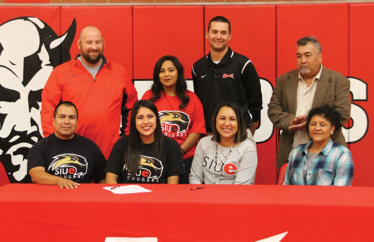Corrina Rivas Signs Her Letter Of Intent To Southern Illinois University Of  Edwardsville In Front Of Her Teammates And Family Members After Her Senior
