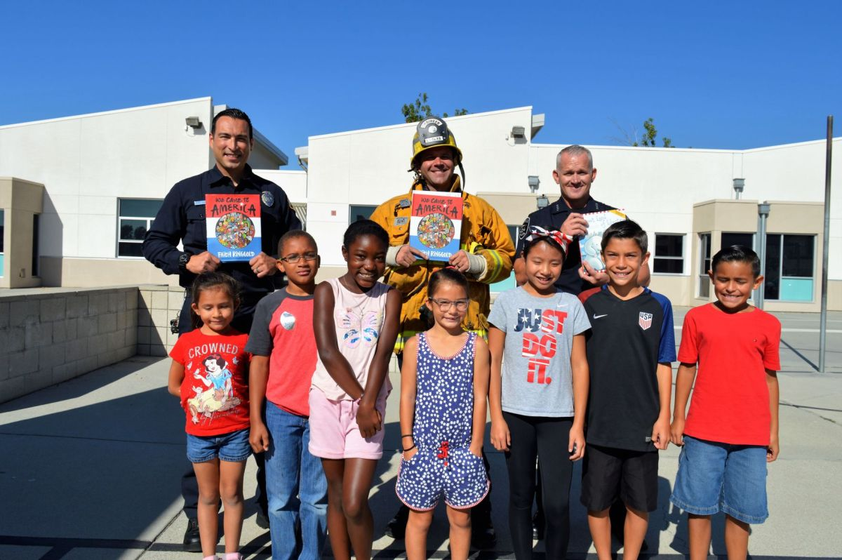 officers firefighters read patriotic