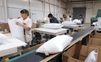 8:59 p.m.: Reopened pillow factory comforts local workers ...