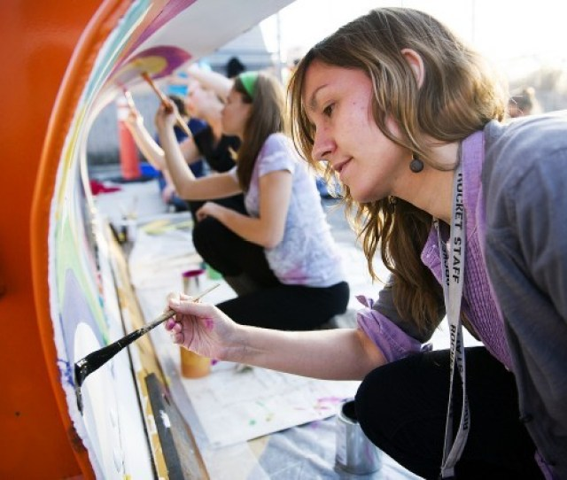 Gay Straight Alliance Club Co Sponsor Maggie Elsener Helps Students Paint A City Snowplow Blade Thursday Nov   At Northeast High School In Lincoln