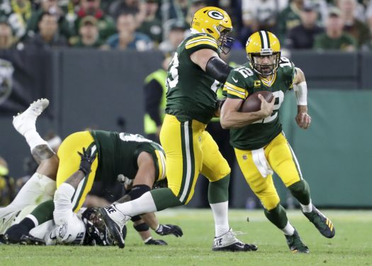 Packers' Aaron Rodgers plans to keep using his legs after ...