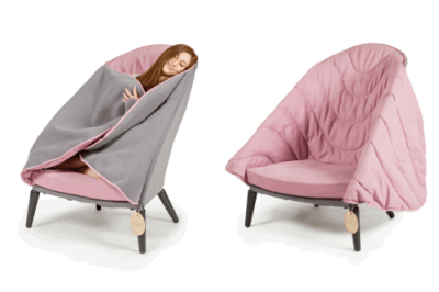 someone designed a cozy cocoon chair that has a built in blanket