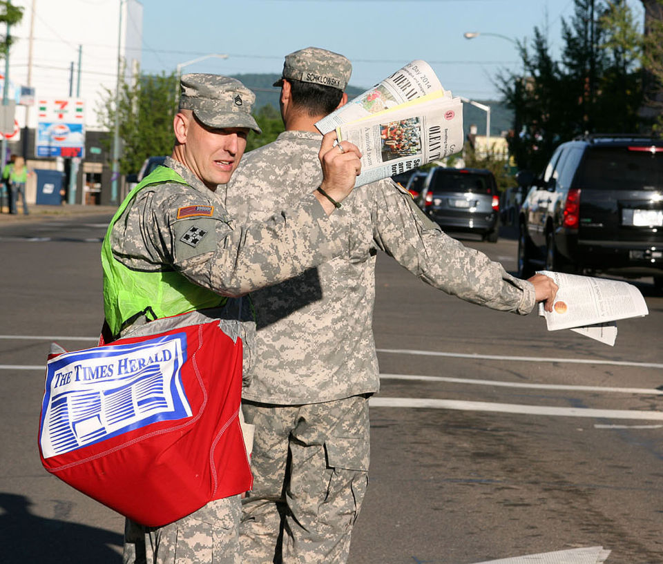 Soldiers sell papers for Community Day