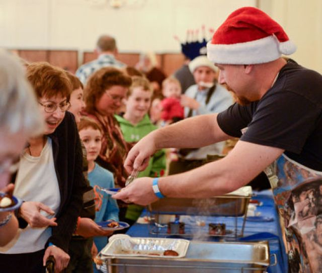 Chris Weaver Serves During The Third Annual Latke Fest At The Temple Beth El In Glens Falls Sunday Dec 1 Shawn Lachapelle Special To The Post Star