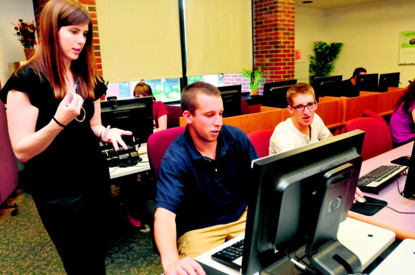 students receiving tech help
