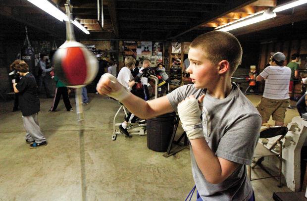 Family House boys choose boxing for discipline exercise