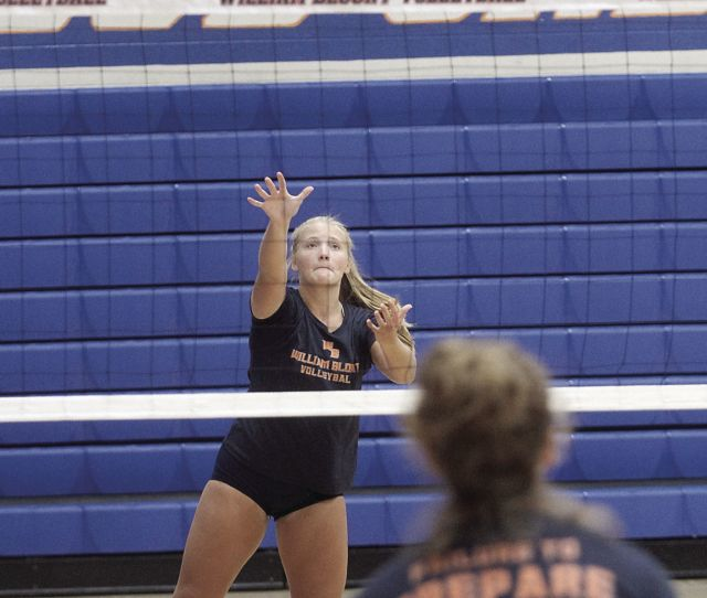 Abby Cross Practices Serves During Practice
