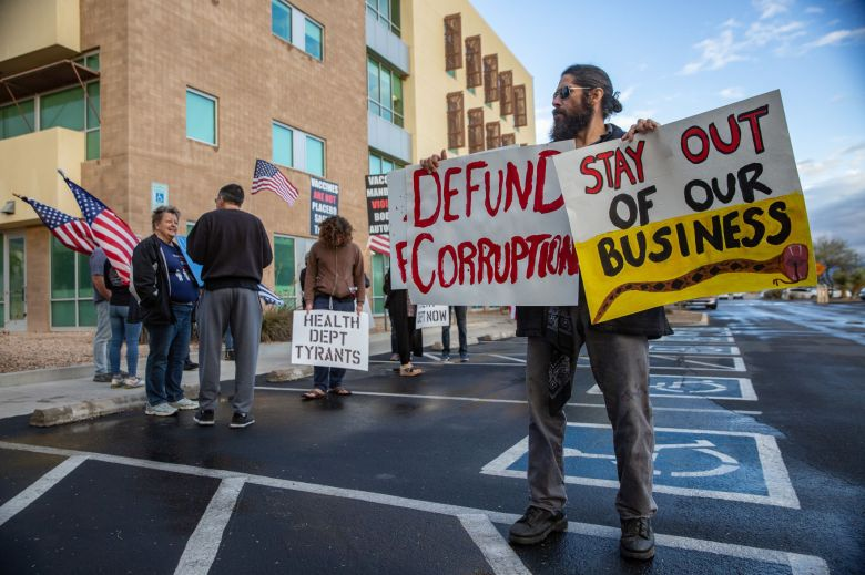 Protesters against new virus safety measures removed from ...