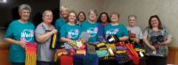 Group makes Special Olympics scarves | Community news ...