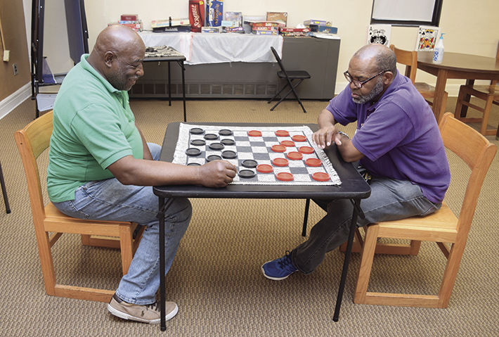 chair games for seniors king sugar land a game of checkers at the lakeview center carolinapanorama com