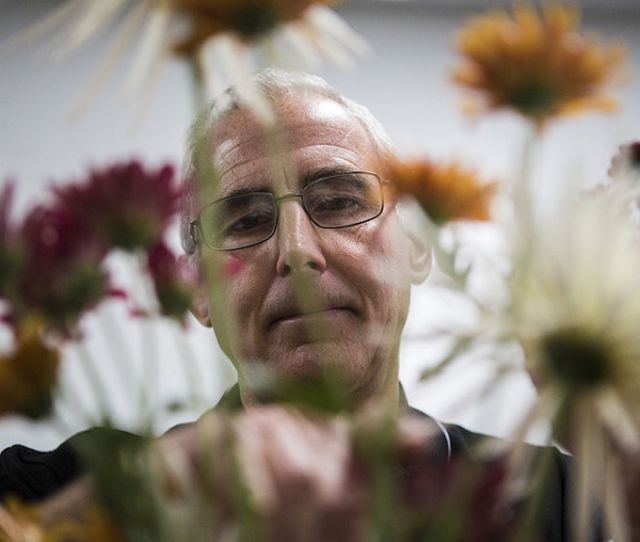 University Of Nebraska Lincoln Associate Professor Of Practice Stacy Adams Cuts And Arranges Flowers In A Vase Display For His Floral Design Class On The
