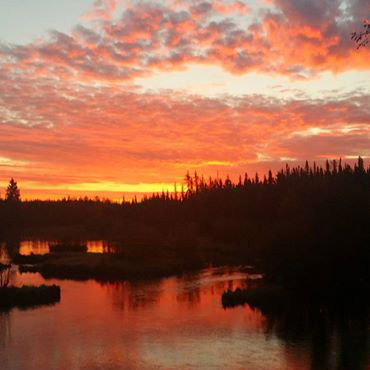 <p>Clinton Miller captured this fiery sunrise over Piledriver Slough on Tuesday.</p>