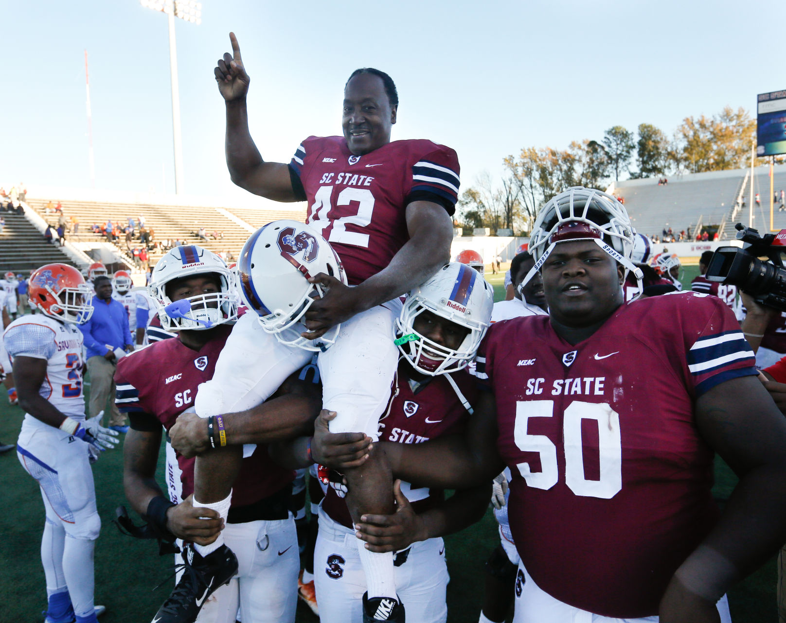 55-year old Joe Thomas carried off the field by his South Carolina State teammates