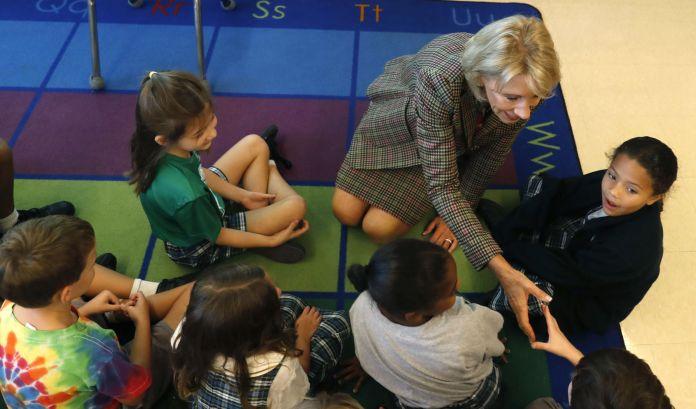 FILE - Betsy DeVos Visits New Orleans school children