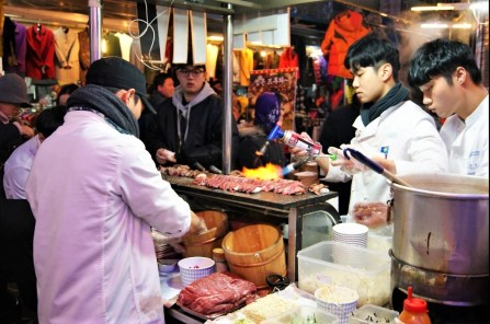 Cooking with an open flame always guarantees an audience. These guys, making beef on rice sushi-style, also got the longest line in the market.
