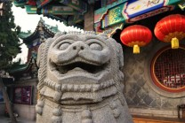 Obviously Qingdao also had temples. This happy fellow stood guard outside of Tianhou.