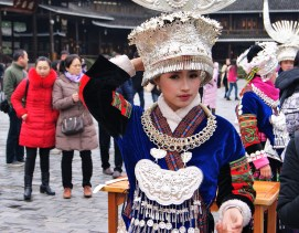 Girl in Miao outfit, just before she forecefed me her rice wine.