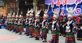 Dance performance in Xijiang, a village showcasing the Miao heritage to tourists.