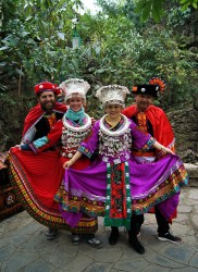Our new friends and us in Miao outfits.