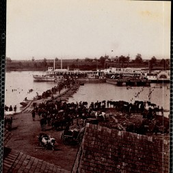 October 2020 E: Evacuation of Port Royal Virginia, May 30, 1864: Group of men, some on horseback, crossing pontoon bridge and boarding ship. Two cows in foreground.
