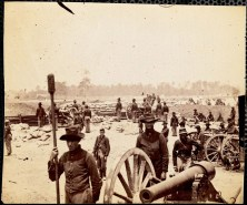 October 2020 H: Fort Sumner Fair Oaks Virginia June 1862: Men in uniform in foreground with cannons. Man at center holding a cannon swab.