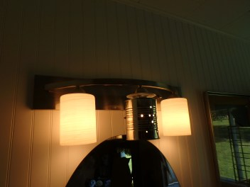 the new light fixture that the previous owners had JUST put in before we bought the farm will have to stay a while so... how to make them more rustic/outhouse-themed? Take the middle one out, tin-punch a design in a can and replace!