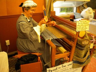 Joy weaving as The Joyful Spinster at my pioneer festival in Ontario, 2014