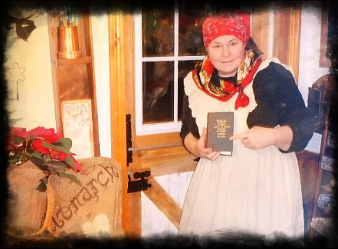 Holding Dr. Chase's book beside my pigeon hole spice shelves, and with a burlapped poinsetta and Rustic Revivals burlap pillow on the other side. Apron was given me by my Grandmother McKenzie, purchased at the old Sparta Mercantile circa 1982