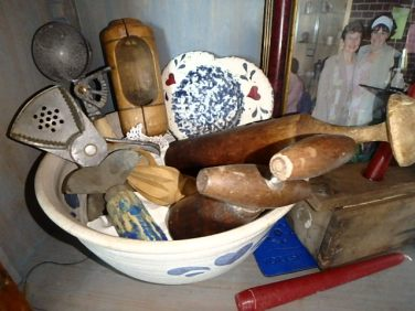 bowl full of old-fashioned kitchen implements - can you name them all?