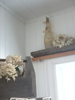 dried hydrangea in a caddy, and along shelves is a lovely and inexpensive way to decorate. Note - another old bottle, filled with coloured water and decorated with a cork and raffia