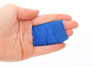 A person's fingers in bandage after not being able to avoid moving injuries.